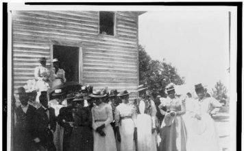 The image African Americans posed outside of church – courtesy of Library of Congress.